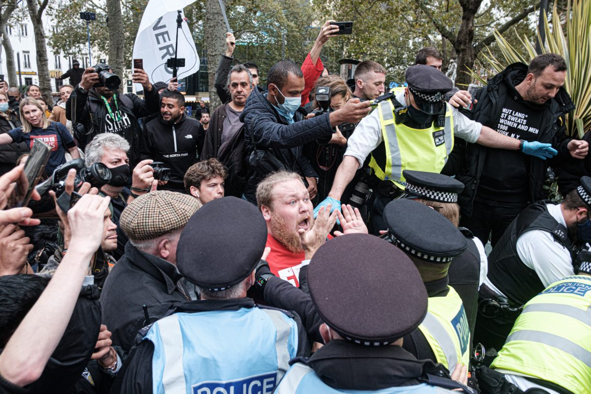 police apparently protect someone speaking